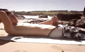 A lone surfer plays with his dick on a beach_x264.mp4-muxed