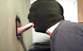 Sucking dick through home made glory hole