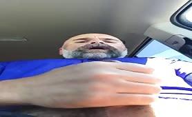 Old man masturbating in his car